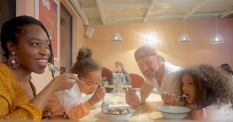 Family shares an ice cream sundae at Miss Lucy's restaurant.