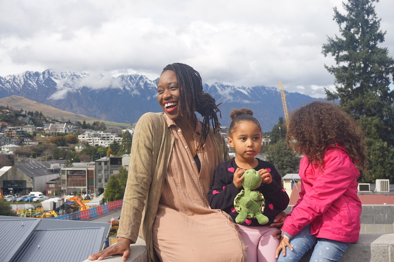 Mom and daughters with The Remarkables mountain range in the background